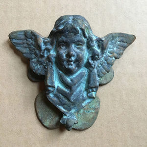 Cherubic angel vintage cast-iron doorknocker